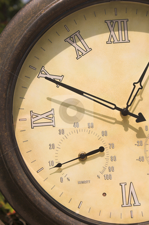 Clock Barometer stock photo, An old clock with a built in barometer. by Robert Byron
