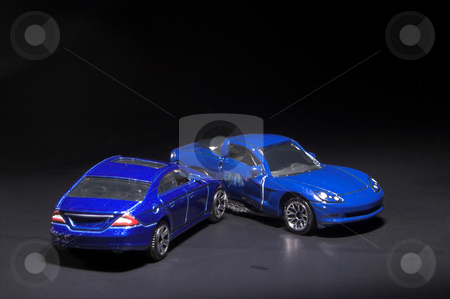 Car Wreck stock photo, A car wreck involving two miniature toy cars. by Robert Byron