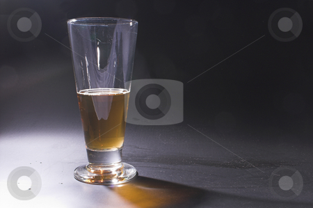 Beer on a Bar stock photo, A glass of  beer on a bar. by Robert Byron