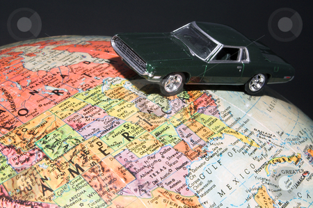 World Travel stock photo, A toy car on a globe - world travel concept. by Robert Byron