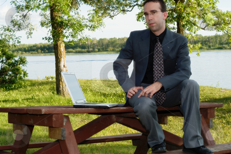 Working Outside stock photo, A young businessman working outside in a park by Richard Nelson