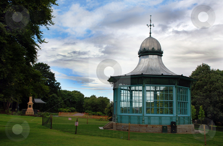 Blue Bandstand stock photo, A photograph of a bandstand in a public park, under a stormy summer sky by Philippa Willitts