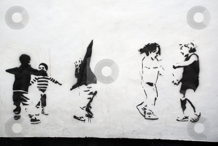 Children Playing Stencil Art stock photo, A photograph of a public wall with stencils of children playing in black by Philippa Willitts