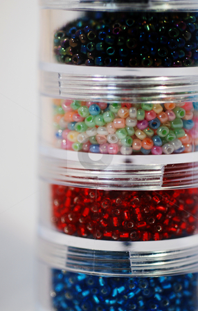 Tubs of Seed Beads stock photo, A close up photograph of four pots of seed beads for craft by Philippa Willitts