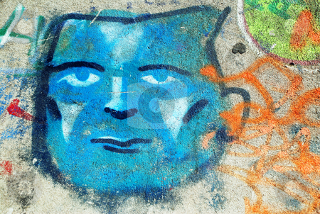 Blue Face Graffiti stock photo, A photograph of a spray painted graffiti face by Philippa Willitts