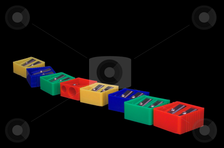 Pencil Sharpeners stock photo, A row of colorful manual pencil sharpeners. by Robert Byron