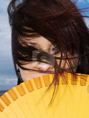 Fan woman stock photo, Woman portrait hiding fan wind yellow long hair by Adrian Costea