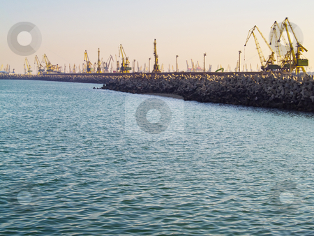 Harbor stock photo, Crains in harbor in a cloudless day at the Black Sea by Adrian Costea