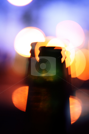 Drunk bottle illusions stock photo, Bottle with multiple shapes and lights in background by Andrey Yanevich