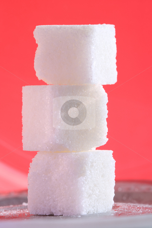 Three sugar cubes on the pink background stock photo, Close-up of three sugar cubes standing on top of each other at the pink background by Andrey Yanevich