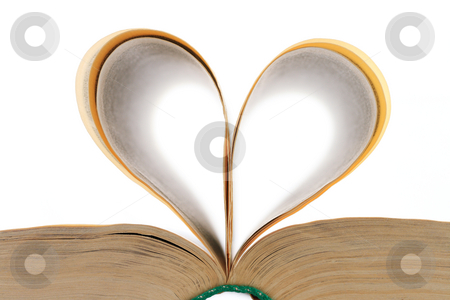Heart shaped leaves of the open book stock photo, Heart shape made from the leaves of the open book on white background by Andrey Yanevich