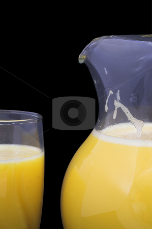 Orange Juice stock photo, Orange juice in a drinking glass and a pitcher. by Robert Byron