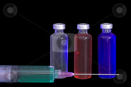 Medicine Vials and Syringe stock photo, Several prescription medicine vials and a syringe. by Robert Byron