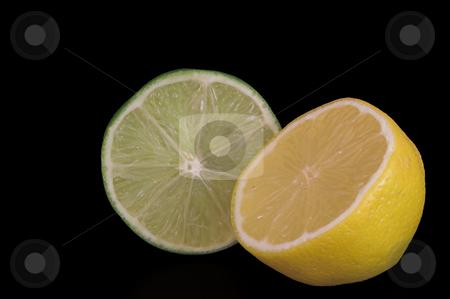 Lemon Lime stock photo, A yellow lemon and a gren lime. by Robert Byron