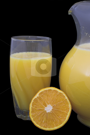 Orange Juice stock photo, Orange juice in a pitcher and drinking glass with orange slices. by Robert Byron
