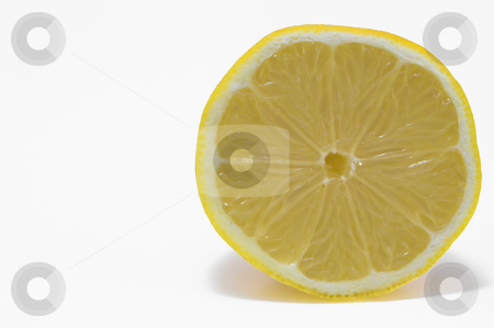 A Yellow Lemon stock photo, A deliciously sour and fresh yellow lemon. by Robert Byron