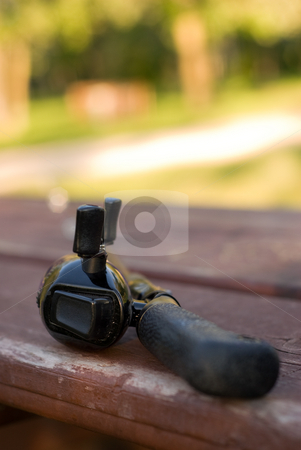 Fishing Rod handle stock photo, A small fishing rod sitting on a wooden table by Richard Nelson