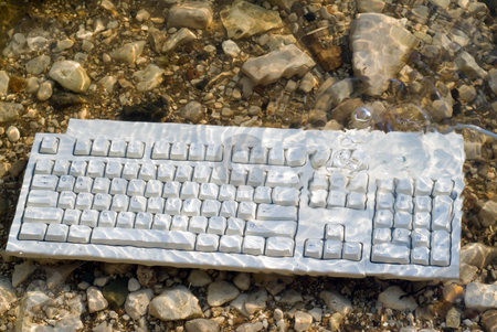 Underwater Keyboard stock photo, A computer keyboard underwater with bubbles coming up by Richard Nelson