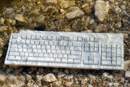 Wet Keyboard stock photo, A wet keyboard thrown in the lake by Richard Nelson