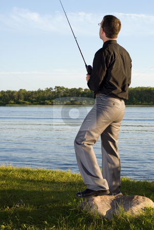 After Work Fishing stock photo, A young businessman at the lake fishing after work by Richard Nelson