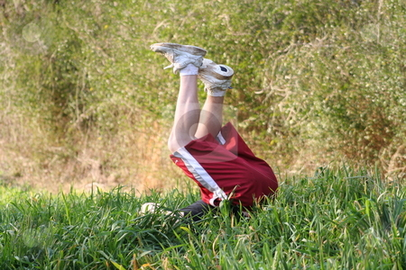 Tumble in the field stock photo, Boy turning a flip in a field by Debbie Hayes