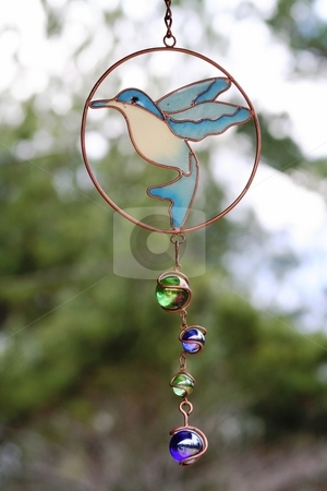 Hummingbird Wind Chime stock photo, This is a picture of a hummingbird suncatcher / windchime by Debbie Hayes