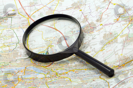 Handglass on a map stock photo, Magnifying glass on a map - close-up by Petr Koudelka