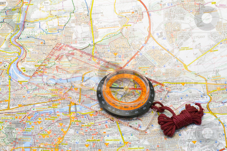 Compass on a map stock photo, A compass lying on a map - close up by Petr Koudelka