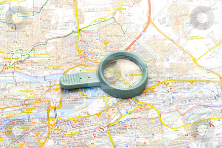 Handglass on a map stock photo, A handglass lying on a map - close up by Petr Koudelka