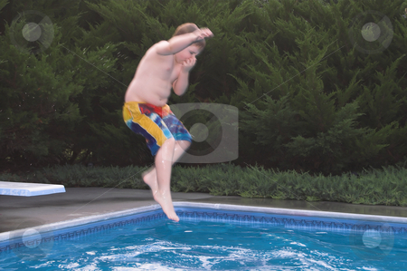 Boy Jumping In a Pool stock photo, A little boy jumping into a pool. by Robert Byron