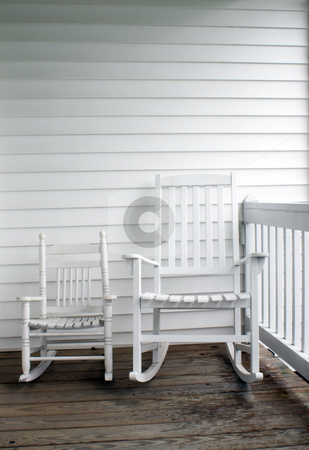 Adult and Child's Rocking Chairs stock photo, An adult's and child's rocking chairs on a front porch. by Robert Byron