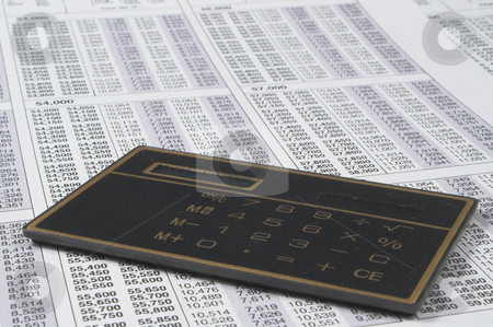 Business Calculator stock photo, A calculator on top of tax forms. by Robert Byron