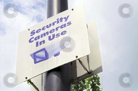 Security Camera Sign stock photo, A sign warning that security cameras are in use. by Robert Byron
