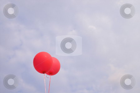 Balloons stock photo, Balloons agianst a cloudy blue summer sky. by Robert Byron