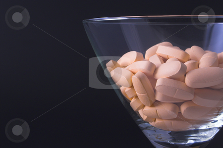 Drug Cocktail stock photo, Pills in a martini glass - Drug abuse concept. by Robert Byron