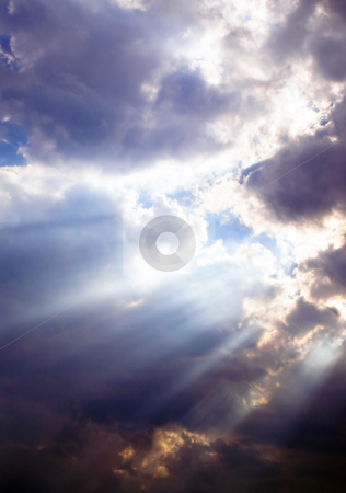 Sunbeams Through the Clouds stock photo, A series of sunbeams shining through storm clouds. by Robert Byron