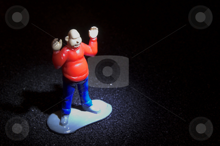 A Caught Criminal stock photo, A criminal caught in a spotlight with his hands up. by Robert Byron