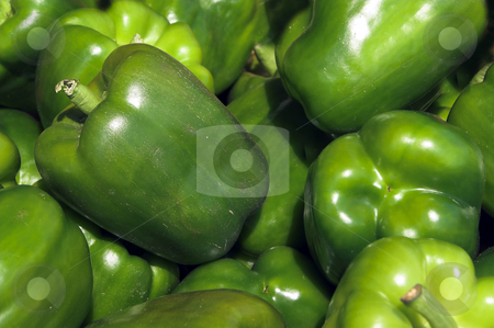 Green Bell Peppers stock photo, A pile of fresh and delicious green bell peppers. by Robert Byron