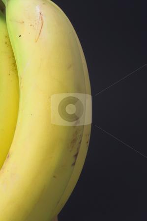 Bananas stock photo, Fresh yellow bananas ready to be eaten. by Robert Byron
