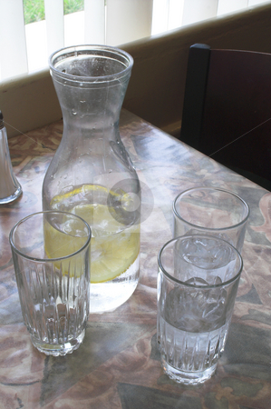 Water Glasses stock photo, A set of water glasses on a restaurant table. by Robert Byron