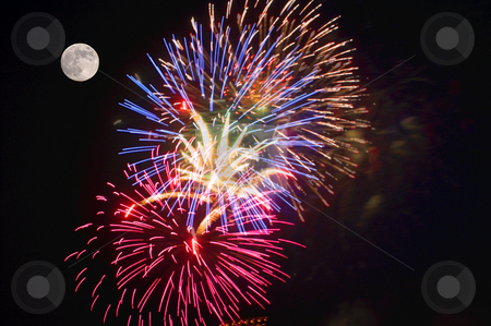 Fireworks at Full Moon stock photo, A fireworks display and a full moon. by Robert Byron