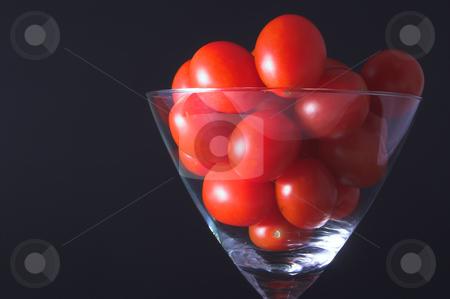 Tomato Martini stock photo, Small grape tomatoes in a martini glass. by Robert Byron