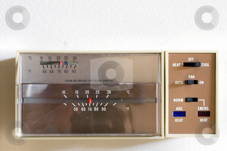 Thermostat stock photo, An indoor thermostat control for heating and air conditioning. by Robert Byron