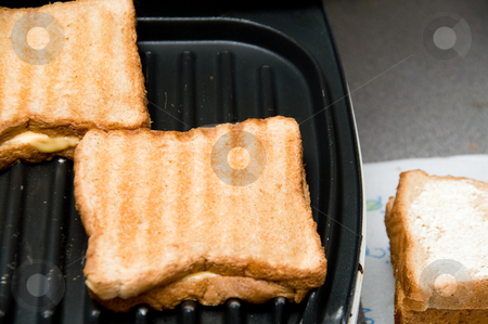 Grilled Cheese Sandwich stock photo, The preparation of a grilled cheese sandwich. by Robert Byron