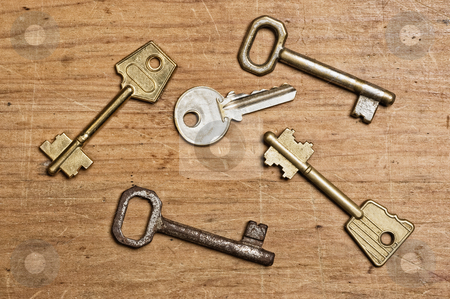 Assorted od keys stock photo, Assorted od keys on a wooden table. by Pablo Caridad