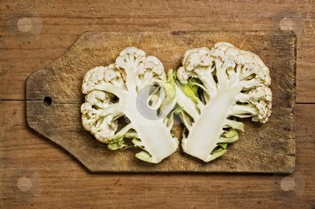 Fresh cut cauliflower stock photo, Fresh cut cauliflower on a wooden table. by Pablo Caridad