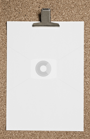 Notepad stock photo, Blank paper with metal clip on cork surface. by Pablo Caridad
