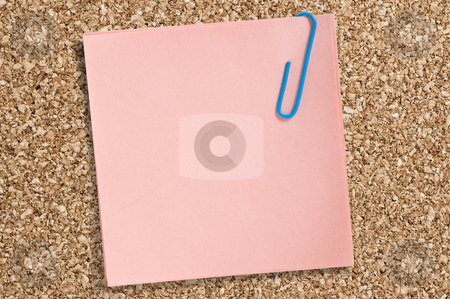 Pink paper note. stock photo, Pink paper note with clip on cork board. by Pablo Caridad