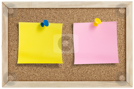 remainder notes on cork board stock photo, Yellow and pink remainder notes on cork board, with tacks. by Pablo Caridad