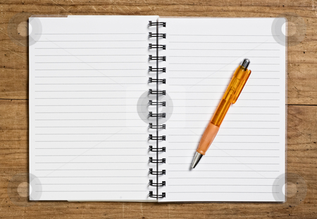 Open spiral notebook stock photo, Open spiral notebook with pen on wooden table. by Pablo Caridad